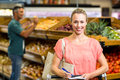 Smiling woman holding the grocery list Royalty Free Stock Photo