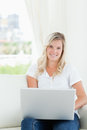 A smiling woman holding a laptop Royalty Free Stock Photo