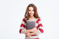 Smiling woman holding laptop computer Royalty Free Stock Photo