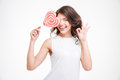 Smiling woman holding lollipop and showing ok sign Royalty Free Stock Photo