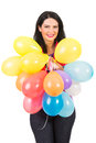 Smiling woman holding plenty balloons many colorful isolated on white background Royalty Free Stock Photo