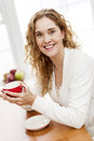 Smiling woman holding red coffee cup Royalty Free Stock Image
