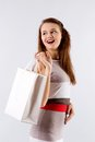 Smiling woman holding shopping white bag young brunette girl in dress with on a background Stock Image