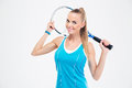 Smiling woman holding tennis racket Royalty Free Stock Photo