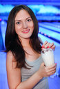 Smiling woman holds milk cocktail in bowling Royalty Free Stock Photo