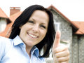 Smiling woman and house Stock Images