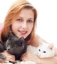 Smiling woman hugging her two cats Stock Images