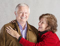Smiling woman and husband senior women holding her happy Royalty Free Stock Images
