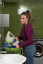 Smiling Woman Ironing Clothes Royalty Free Stock Photo