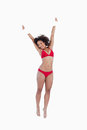 Smiling woman jumping while raising a blank poster above her hea Royalty Free Stock Photos