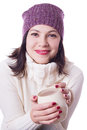Smiling woman in knitted hat holding cup of beverage over white Royalty Free Stock Image