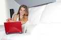 Smiling woman with laptop at home Royalty Free Stock Photo