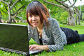 Smiling Woman With Laptop In N...