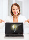 Smiling woman with laptop pc Stock Photos