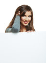 Smiling woman leaning on big blank board close up female face portrait with arms card Royalty Free Stock Photography