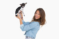Smiling woman lifting her chihuahua Royalty Free Stock Photo