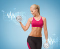 Smiling woman lifting steel dumbbell fitness healthcare and dieting concept young sporty Stock Image