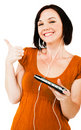 Smiling woman listening media player Royalty Free Stock Photo