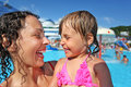 Smiling woman and little girl bathing in pool Stock Images