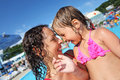 Smiling woman and little girl bathing in pool Stock Photo