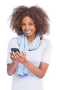 Smiling woman looking at camera and typing a text message on white background Stock Images