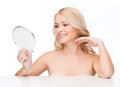 Smiling woman looking at mirror Royalty Free Stock Photography