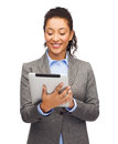 Smiling woman looking at tablet pc business internet and technology concept african american computer Royalty Free Stock Photo