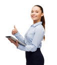 Smiling woman looking at tablet pc computer business gesture internet and technology concept showing thumbs up Stock Photography