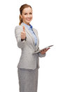 Smiling woman looking at tablet pc computer Royalty Free Stock Photo