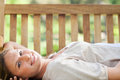Smiling woman lying on a bench Royalty Free Stock Photo