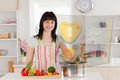 Smiling woman making dinner using hologram interface in the kitchen Stock Photography
