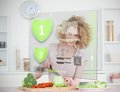 Smiling woman making salad using hologram interface in the kitchen Royalty Free Stock Photos