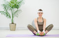 Smiling woman making stretching exercises Royalty Free Stock Photography