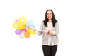 Smiling woman with many balloons happy holding colorful isolated on white background Stock Photos