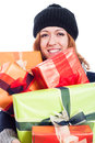 Smiling woman with many presents in winter hat holding isolated on white background Royalty Free Stock Photos