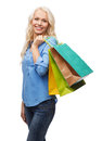 Smiling woman with many shopping bags retail and sale concept Stock Photos