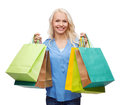 Smiling woman with many shopping bags retail and sale concept Stock Photography