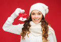 Smiling woman in mittens and hat with jingle bells christmas x mas winter happiness concept Royalty Free Stock Photos