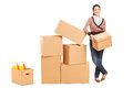 Smiling woman moving into a new home Royalty Free Stock Photos