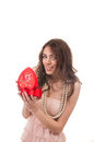 Smiling woman opening heart shaped gift box on valentine s day sexy young red Royalty Free Stock Images