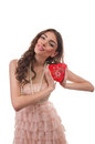Smiling woman opening heart shaped gift box on valentine s day sexy young red Stock Photos