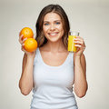 Smiling woman with orange fruit and juice isolated portrait. Royalty Free Stock Photo