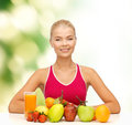 Title: Smiling woman with organic food or fruits on table