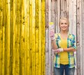 Smiling woman with paintbrush repair construction and maintenance concept Stock Images
