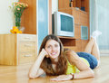 Smiling woman on parquet floor at home Stock Photo