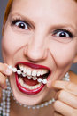 Smiling woman with pearl necklace Royalty Free Stock Photography