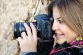 Smiling woman and photo camera Royalty Free Stock Photo