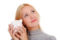 Smiling woman with piggy bank Royalty Free Stock Photography
