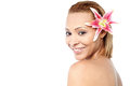 Smiling woman with pink lily flower beautiful young in hair Stock Image