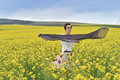 Smiling woman playing with scarf in a canola field Royalty Free Stock Photo
